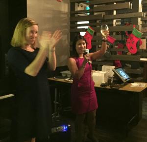 Sharon Lee, IABC/Calgary Vice President, and Melanie Simmons, CPRS Calgary President, toast the holiday season.